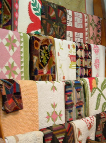 Picture of quilts on racks in the interior of Rocky Mountain Quilts.